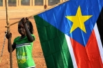 Girl-holds-South-Sudan-flag.jpg
